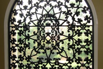 iron motif on window