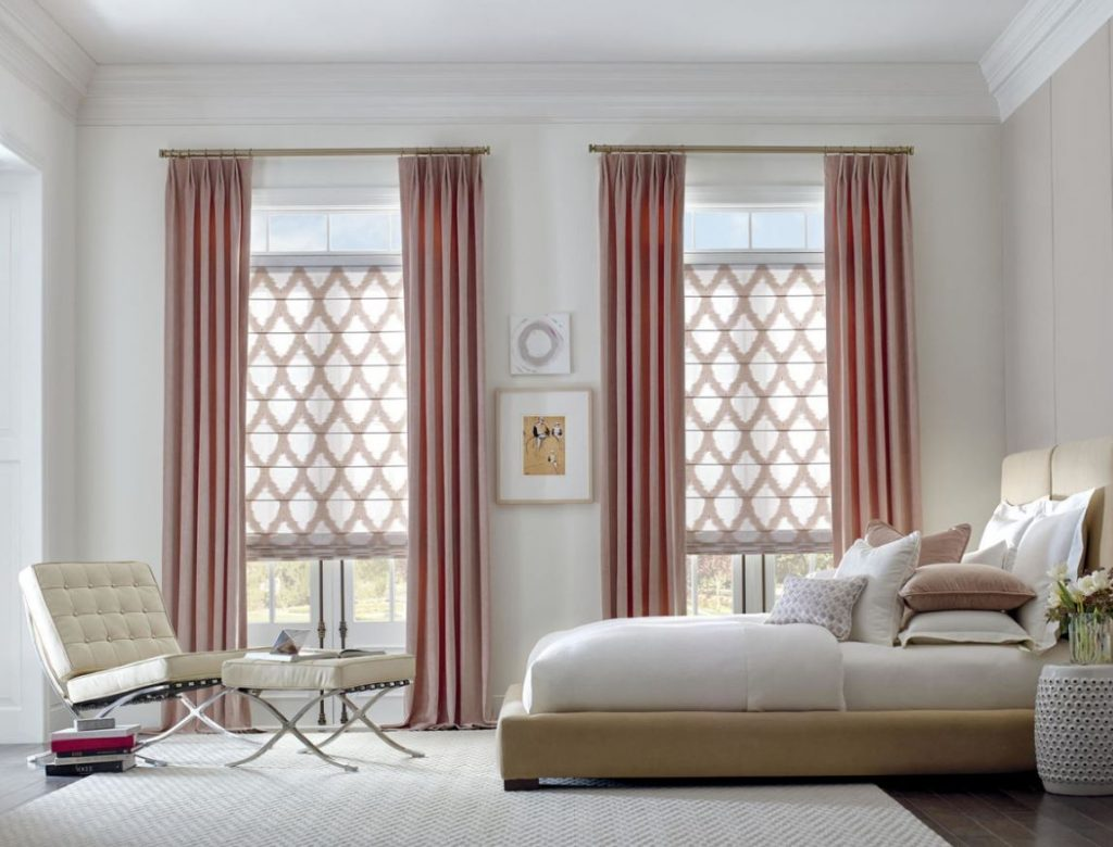 Bedroom with window tow large windows, pink curtains, lounge chair